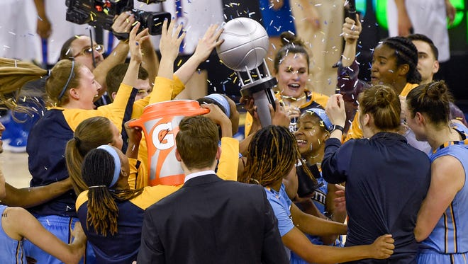The Marquette women's basketball team celebrates its Big East tournament title last season.