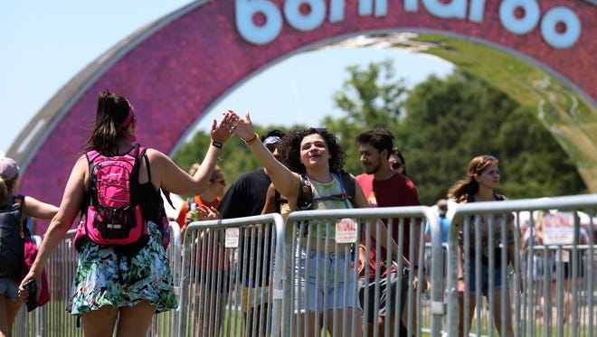 Festival patrons high five at the Bonnaroo Music and Arts Festival in Manchester, Tenn, on Thursday June 7, 2018.