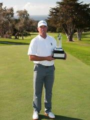John Dal Corobbo with his championship trophy at the 27th Senior PGA Professional National Championship.