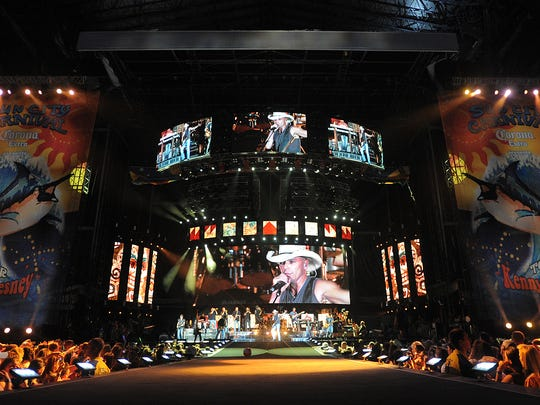 Kenny Chesney and his band perform Lucas Oil Stadium.