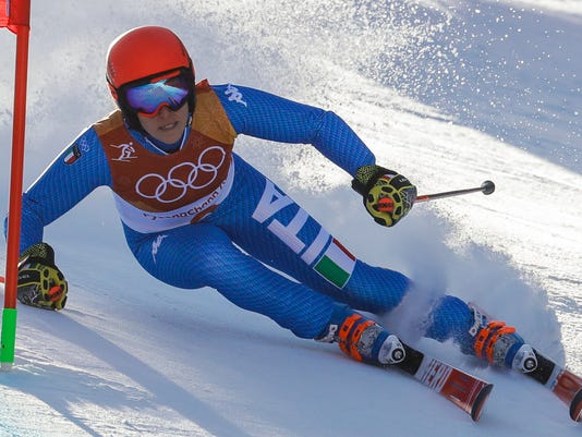 Federica Brignone, of Italy, attacked the gate during the first run of the Women's Giant Slalom at the 2018 Winter Olympics in Pyeongchang, South Korea, Thursday, Feb. 15, 2018., Thursday, Feb. 15, 2018. (AP Photo/Michael Probst)