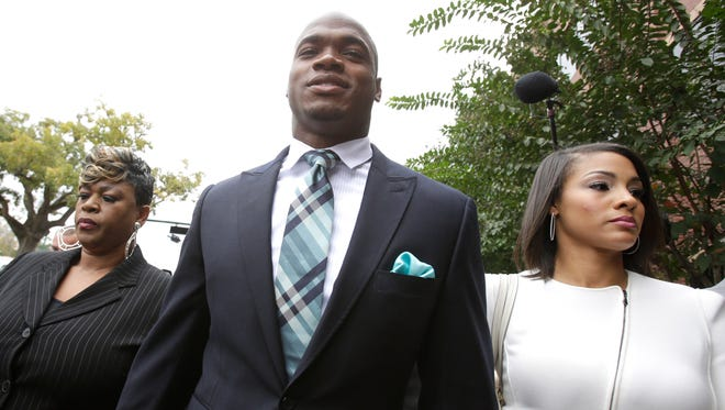 Adrian Peterson, with his wife, Ashley Brown Peterson, arrive at the courthouse where Peterson avoided jail time in a plea deal.