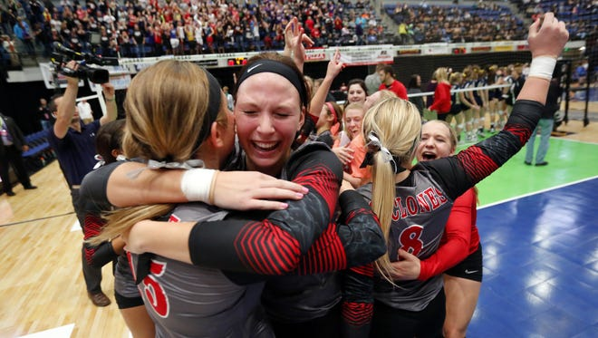 Harlan celebrates after beating Sioux City Heelan in a Class 4A state semifinal Thursday, Nov. 12, 2015.