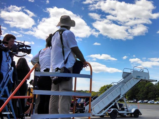 Members of the press await the president's arrival at Westchester County Airport Friday afternoon.