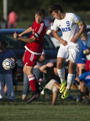 Millville's Michael Gluszak, right, takes on Vineland's Ryan Cleveland Thursday in Millville.
