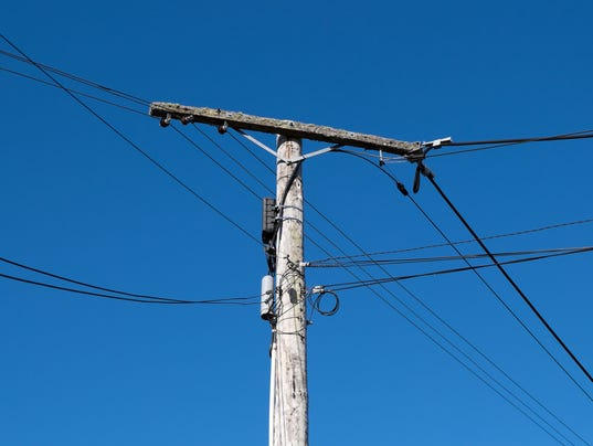 Old wooden telephone or power pole