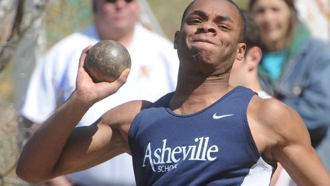 An Asheville School athlete competes in the shot put during the Buncombe County track meet.