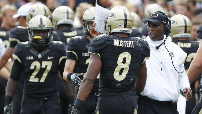 Head coach Darrell Hazell meets Raheem Mostert on the sidelines after Mostert's touchdown at 8:01 of the third quarter against Western Michigan