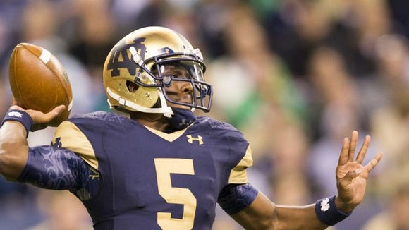Everett Golson, Notre Dame quarterback, rears back to pass, third quarter, Purdue and Notre Dame football at Lucas Oil Stadium, Indianapolis, Saturday, September 14, 2014.