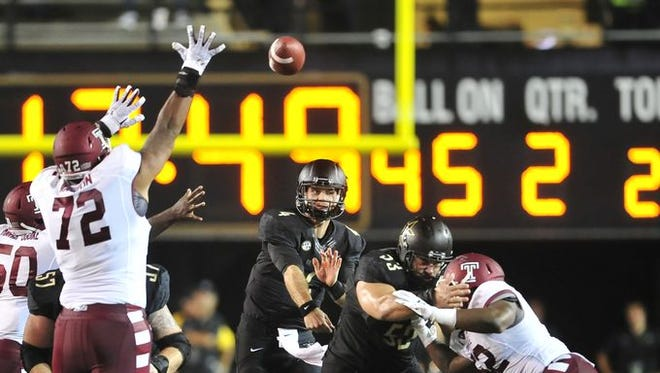 Patton Robinette throws a pass versus Temple.