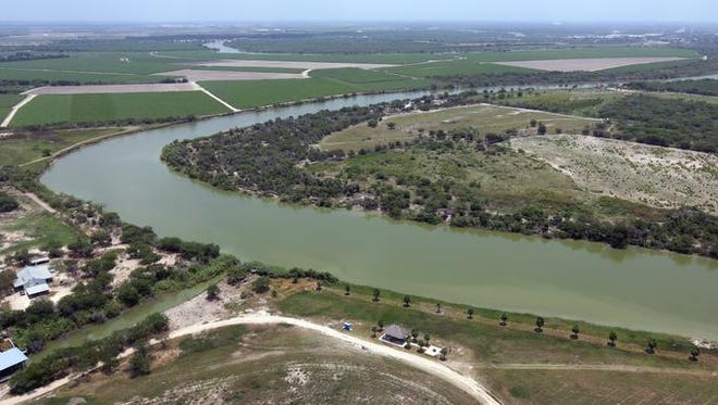 The bend in the Rio Grand is photographed from a Texas Department of Public Safety helicopter on patrol, Thursday, July 24, 2014, in Mission, Texas. Texas is spending $1.3 million a week for a bigger DPS presence along the border.