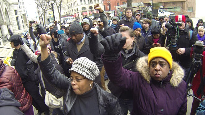 Protesters march in Milwaukee on Monday after authorities announced a white Milwaukee police officer who fatally shot a mentally ill black man in April won't face criminal charges. Milwaukee County District Attorney John Chisholm said Christopher Manney won't be charged because he shot Dontre Hamilton in self-defense.
