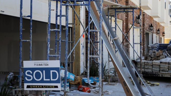 New townhouses under construction in Houston. New-home sales fell to 10-month low in December, the Commerce Department said Thursday.