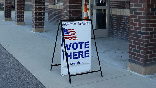 Western International High School is a polling place for the primary election and is using new voting machines on Tuesday, Aug. 8, 2017, in Detroit.