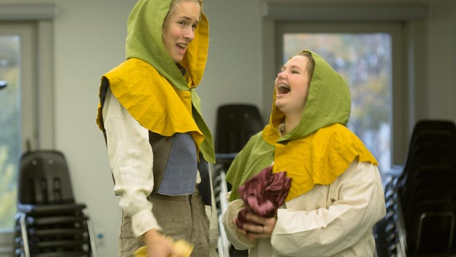 """Prince Henry, played by Elena Brotz, left, of Burlington and close friend Poins, played by Thea Thompson of St. George, celebrate their successful prank to outwit a fellow thief. The are members of the Hour Glass Youth Theatre, which will present one of William Shakespeare's lesser known dramas """"Henry IV, Part One."""""""