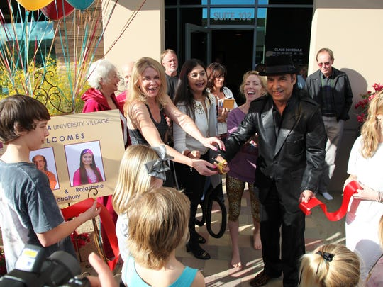 Owners of Bikram Yoga University Village celebrate the grand opening of their facility on Cook Street in Palm Desert.