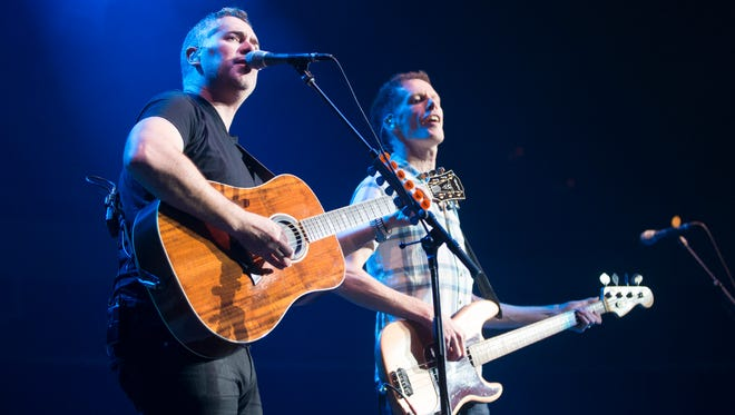 Barenaked Ladies lead singer Ed Robertson (left) and bassist Jim Creeggan perform for fans at the Arizona State Fair October 22, 2014.