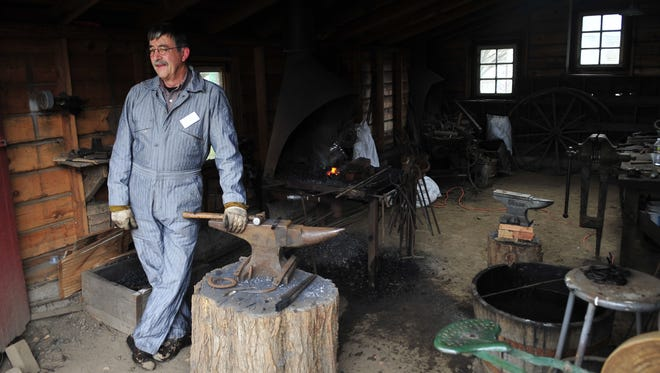 Dan Donaldson works in the blacksmith shop at Willamette Heritage Center. The center's new Urban Homesteading series teaches the skills of the 19th century frontier.