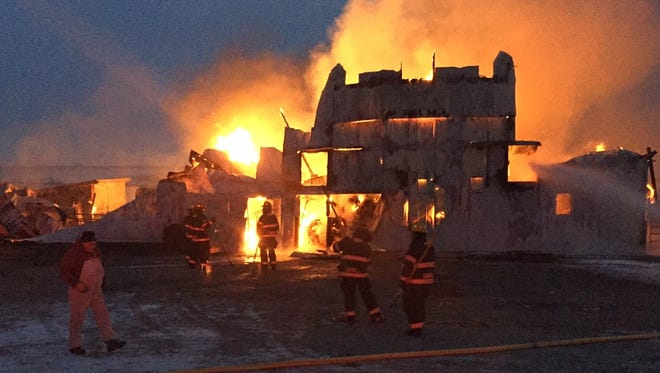 Grinnell fire fighters battle a barn fire early Wednesday morning, Dec. 14 north of Grinnell. A total of 32 firefighters battle the blaze as mutual aid was requested from Kellogg, Malcom, Gilman and Montour fire departments to transport more than 80,000 gallons of water.