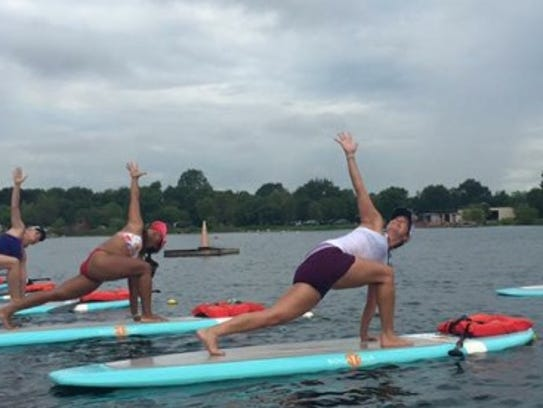 The SUP Yoga Pond sponsored by the YMCA and Wesley