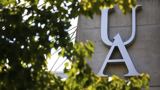 The University of Akron logo is seen through the trees on Buchtel Avenue.