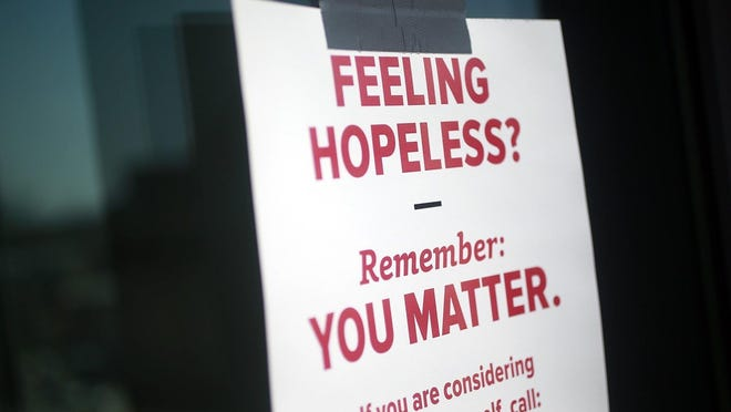 An student group left notes at a parking garage in Columbus, Ohio for people considering suicide to see in April 2018.