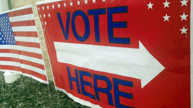 A sign directs voters.