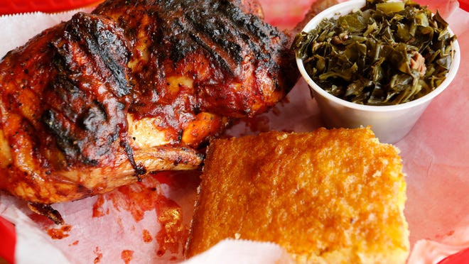 Barbecue chicken with sides of Southern greens and corn bread Friday, March 20, 2015, at South Street Smokehouse, 3305 South St., No. 6, in Lafayette.
