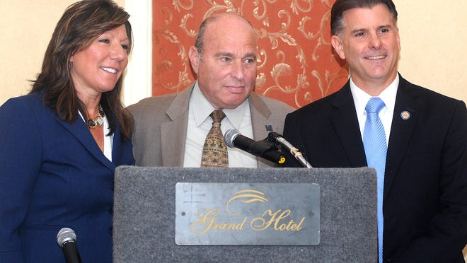 Dutchess County Regional Chamber of Commerce President Charles North, center, thanks Dutchess County Legislator Sue Serino, left, (R,C,I–Hyde Park) and New York State Senator Terry Gipson, right, (D–Rhinebeck) for their participation in a forum Wednesday at the Poughkeepsie Grand Hotel.