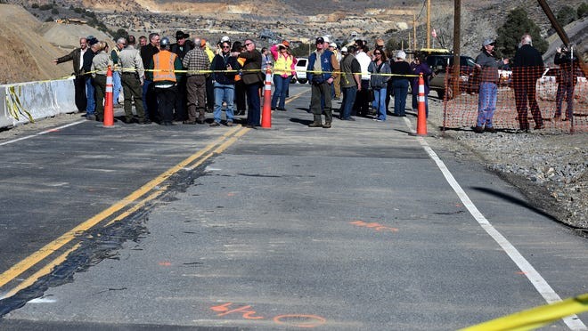 Local residents and officials gather on the north end of the Nevada 342 where cracking and sinking occurred after heavy rain storms earlier this month. The public was given a tour of the area where NDOT district engineer Thor Dyson, Comstock Mining personnel, and elected officials answered questions.