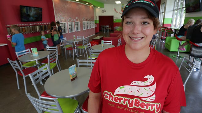 Katie Walker stands in the dining room at the CherryBerry self-serve yogurt bar in Wausau.