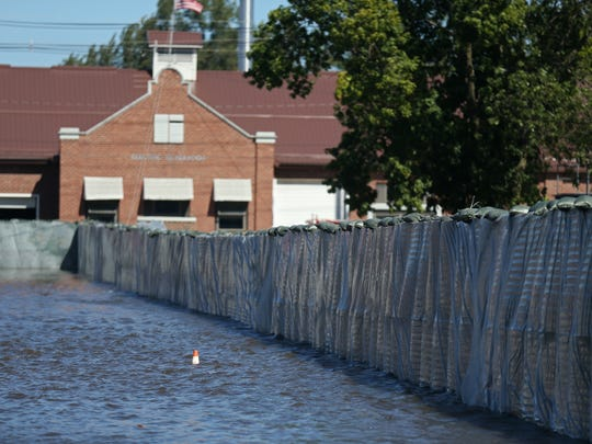 HESCO barriers protect Vinton's fire department and electric utility plant from flood water on Monday, Sept. 26, 2016.