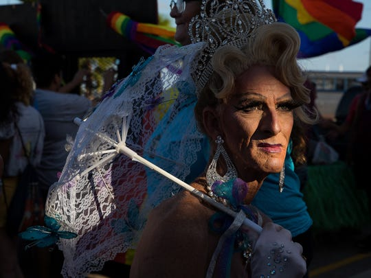 Leona Lane waits to take part in the second annual Corpus Christi pride parade downtown on Friday, June 8, 2018.