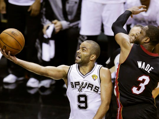 San Antonio Spurs guard Tony Parker (9) shoots against Miami Heat guard Dwyane Wade (3) during the first half in Game 2 of the NBA basketball finals on Sunday, June 8, 2014, in San Antonio. (AP Photo/Tony Gutierrez)