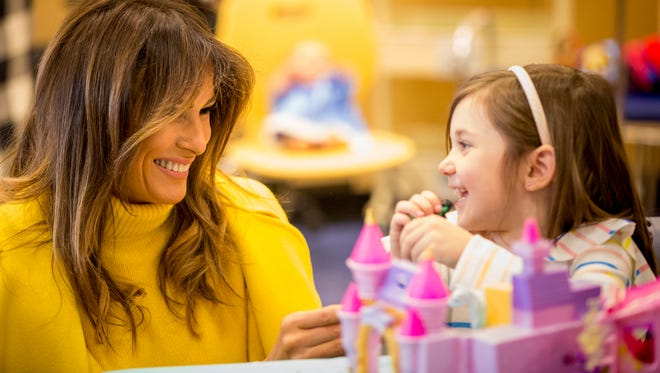 First lady Melania Trump plays with Maya Baughman at an activity center at Cincinnati Children's Hospital Medical Center Monday, February 5, 2018.