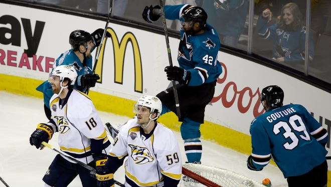 The San Jose Sharks' Joel Ward (42) celebrates after scoring against the Nashville Predators during the third period of Game 1 in the  Western Conference semifinals on April 29, 2016. San Jose won 5-2.