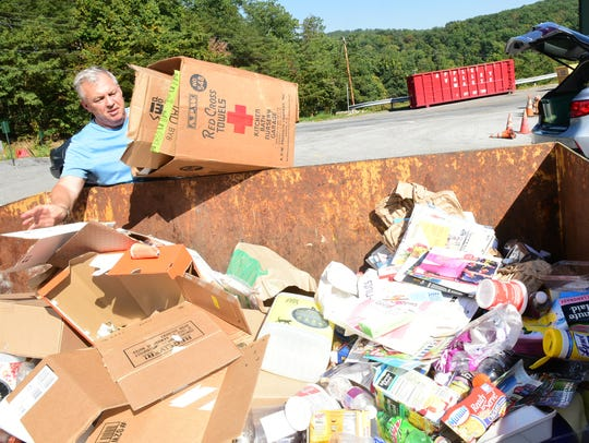 Bill Smith drops off items to be recycled on Wednesday,
