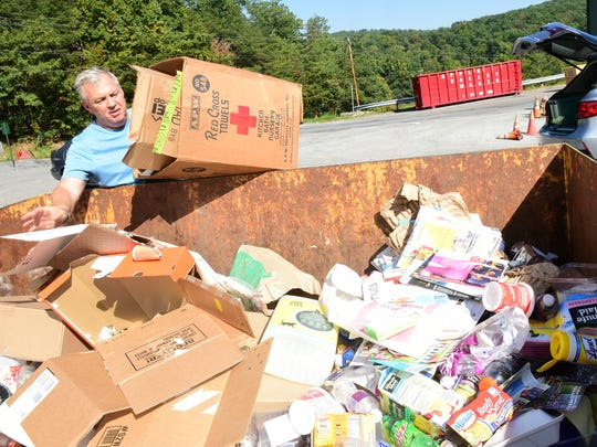 Bill Smith drops off items to be recycled on Wednesday, September 27, 2017 at Washington Township Transfer Station. WTTS no longer has an assembly line where workers separate items.