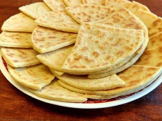 Potato scones, an Irish breakfast item prepared on