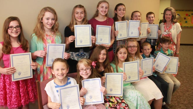 Local piano students recently gave a recital where they played memorized piano solos, duets, and concerto. Students were awarded certificates, flowers, pens and rating certificates for solos and piano concertos which they earned at the Junior Festival of National Federation at Evangel University in Springfield, Mo. Shown are, first row, from left, Deanna Human and Joanna Oliger, first superior solos; Trevi Sheaner and Jessalin Means, third consecutive superior solos; Emma Darracq, second consecutive superior solo; Titus Bennett, first superior solo; and Jack Sheaner, third consecutive superior solo, second row, Ali Collins, fourth consecutive superior solo; Lauren Oliger, first superior solo; Ellise Darracq, third consecutive superior solo; Azelin Means, sixth consecutive superior solo; Kelly Connelly, 10th consecutive superior solo and second consecutive superior concerto; Heather Spencer, eighth consecutive superior solo; Caleb Bennett, third consecutive superior solo, and instructor Caryl Reddick.