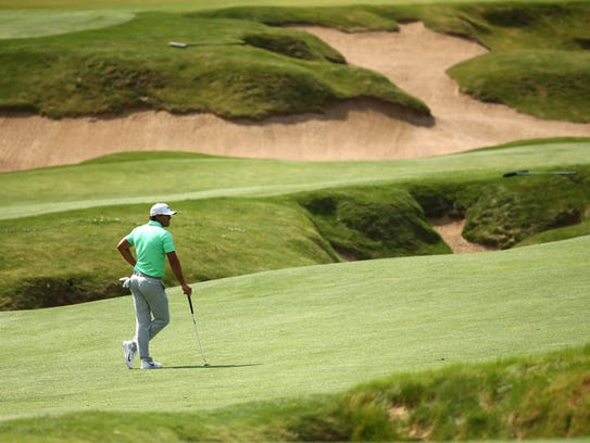 Brooks Koepka stands in one of the expansive fairways
