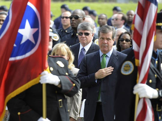 Nashville Mayor Karl Dean, center, stands for the honor guard during his annual State of Metro address May 1, 2012. Behind Dean is Jesse Register, director of schools for Metro Nashville Public Schools.