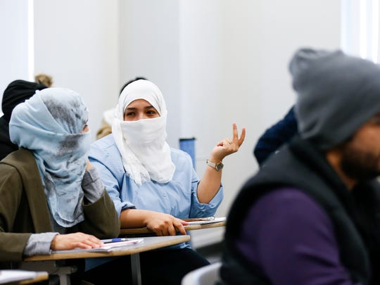 Jawhara Almghrabi participates in a class discussion during a writing class at the English Language Institute at Missouri State University on Tuesday, Feb. 20, 2018. Twenty-eight English teachers from Saudi Arabia are taking part in a 12-month teacher training program at Missouri State University with the goal of improving the educational system in Saudi Arabia.