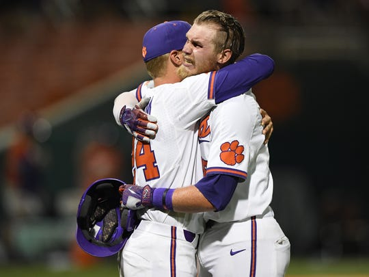 Clemson first baseman Seth Beer (28), right, is consoled by teammate Jake Higginbotham (24) after the Tigers 19-6 loss to Vanderbilt in the Tiger's NCAA Clemson Regional at Doug Kingsmore Stadium in Clemson Sunday, June 3, 2018.