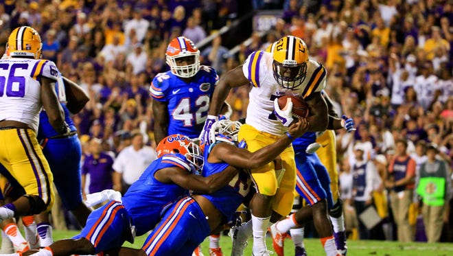LSU Tigers running back Leonard Fournette churns for yards against Florida.