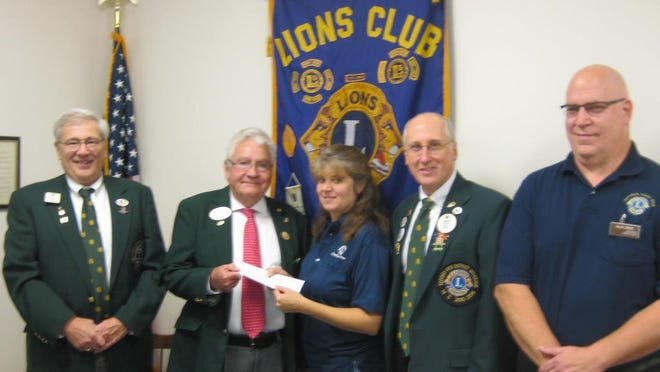 Pictured, from left, are: First Vice District Governor Kerry McKnight, of the New Freedom Lions Club; District Governor John Griffie, of the New Oxford Lions Club; Jacobus Lions President Tammy Ream; Second Vice District Governor Dennis Cope, of the Arendtsville Lions Club; and Zone 4C Chairperson Alan Diehl, of the Jacobus Lions Club.