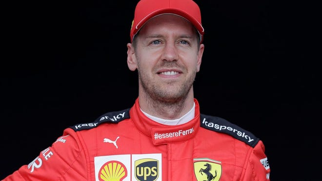 Ferrari driver Sebastian Vettel of Germany poses for a photo at the Australian Formula One Grand Prix in Melbourne. Four-time Formula One champion Sebastian Vettel will leave Ferrari at the end of the year, the Italian team said Tuesday, May 12, 2020. Ferrari said the decision was by mutual consent.