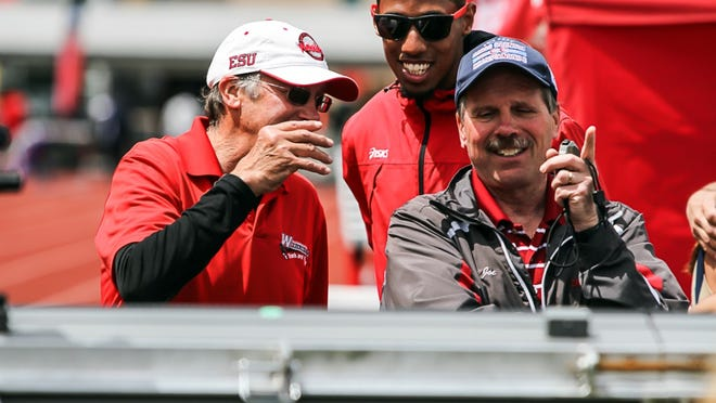Longtime East Stroudsburg University cross country and track and field coach Joe Koch, right, is retiring after a 37-year career, effective Sept. 25.
