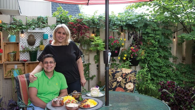 Sherry Bayegan (standing) and Rezi Haghiri, owners of Charmy's Persian Cuisine