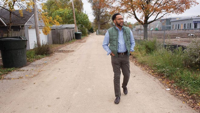 NBC4 co-anchor Kerry Charles walks toward the construction entrance to the new recreation center in his old neighborhood of Linden.